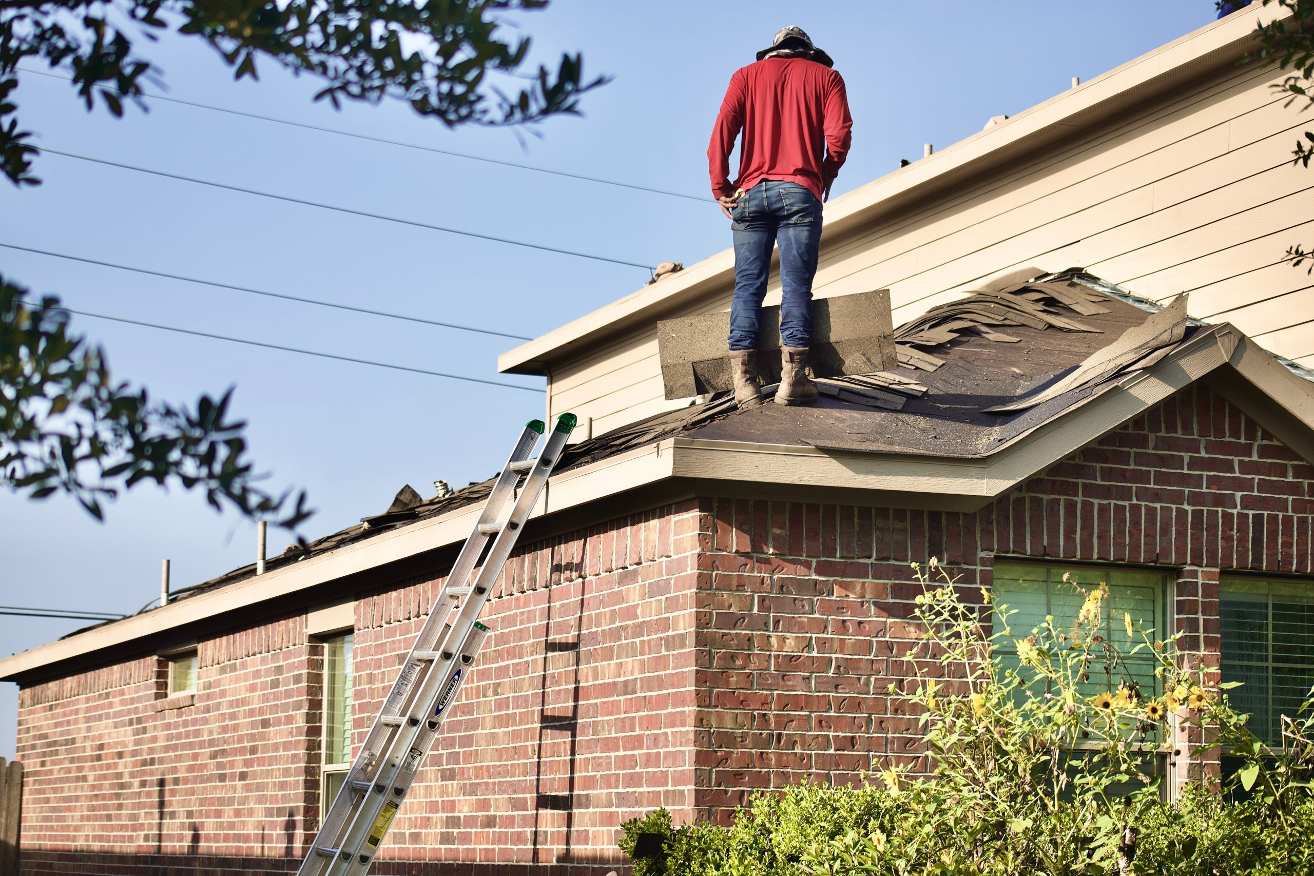 A man is fixing a roof